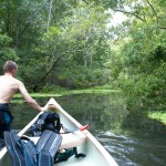 Walking the canoe up the Garner Spring run