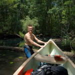 James pulling the canoe up river towards Minnow Spring
